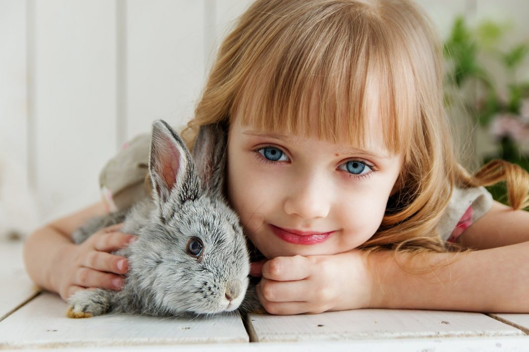 Baby Girl with Rabbit